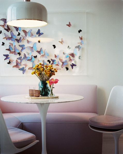 Saarinen Tulip table and chairs with corner banquette in dusky pastel pink.