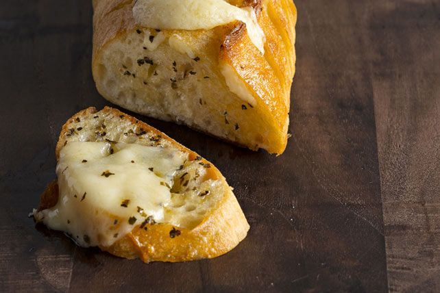The secret to the best-ever garlic bread? Just spread slices of French bread with a butter mixture and add slices of cheese before baking.