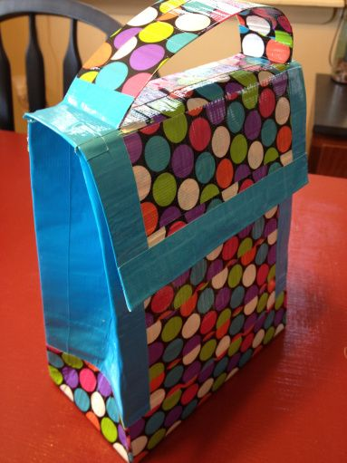 Duck Tape Lunch Box- Simply take a regular paper bag and carefully cover it in a couple layers of your favorite patterned tape! Go the extra mile and tape on a handle made from strips of tape.