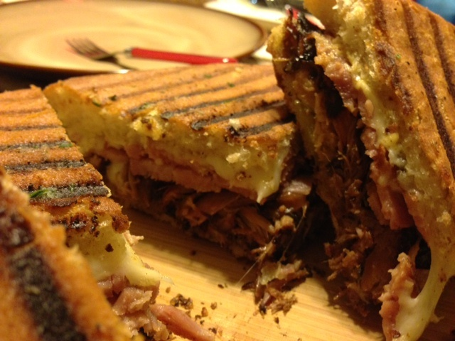 I made these cuban panini's! roasted pulled pork, honey ham, swiss, bread and butter pickles, mayo/mustard/horseradish blend, foccacia bread! I didn't have a panini press so I put the sandwich in my cast iron grill pan and then placed a foil covered brick on top. I flipped it to mark the other side and then I put the whole thing in the oven. FANTASTIC!! - I used the attached link for my mayonnaise base and pork marinade.