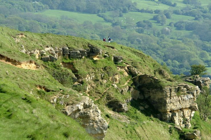 cotswolds england | Cotswold Crag - Cleeve Hill with walkers in the distance