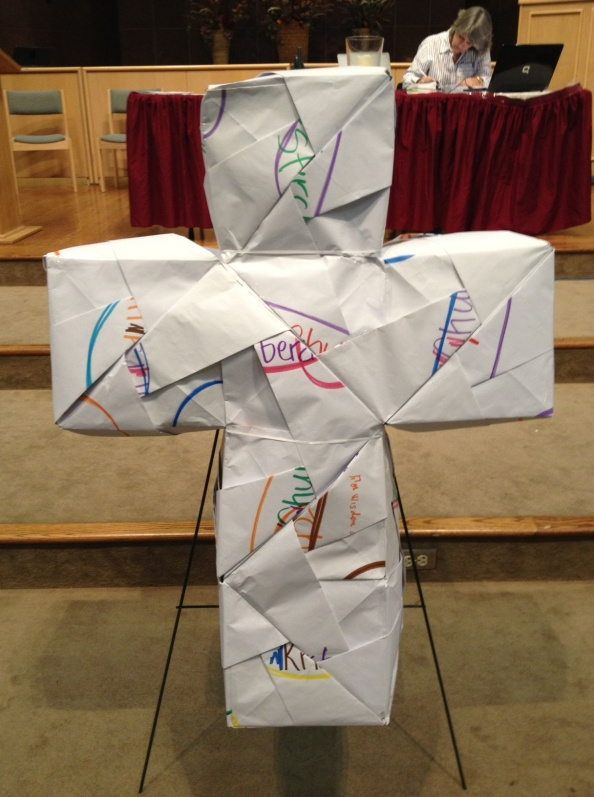 Paper cross...prayer station then Theresa Cho folded the papers into three 3-D crosses stuffed with newspaper...at presbytery meeting