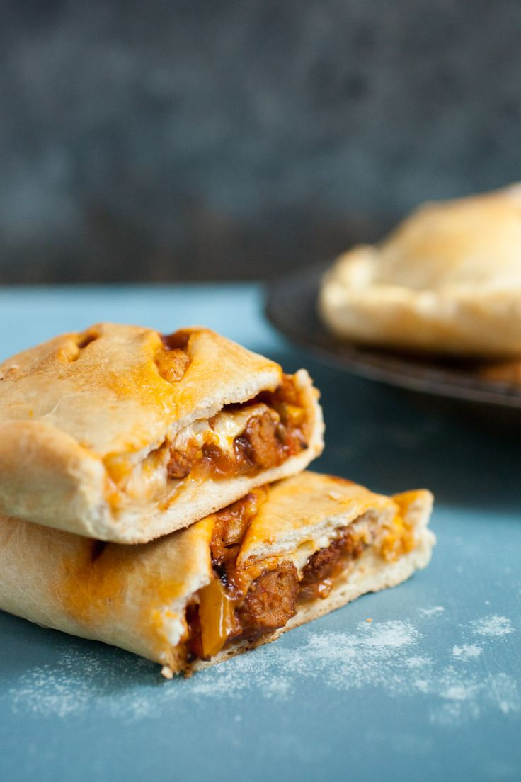 Sausage and Pepper Hot Pockets: These delicious homemade hot pockets are stuffed to the max with sausage, peppers, and cheese. They freeze perfectly as well and make for quick meals whenever you need one! | macheesmo.com