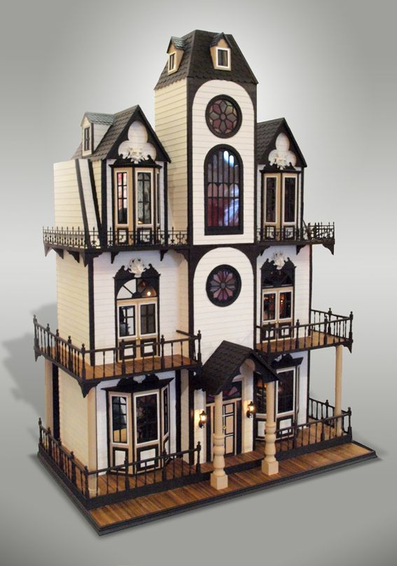 I picture this as being a doll house for a very spooky little girl. Looks like the Adams Family house .