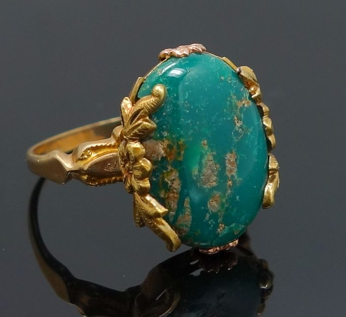 The ring is superbly crafted in 10k yellow gold and features an ornate floral setting around the face. The ring is set with a large turquoise cabochon in a vivid shade of dark bluish-green with taupe matrix. | eBay!