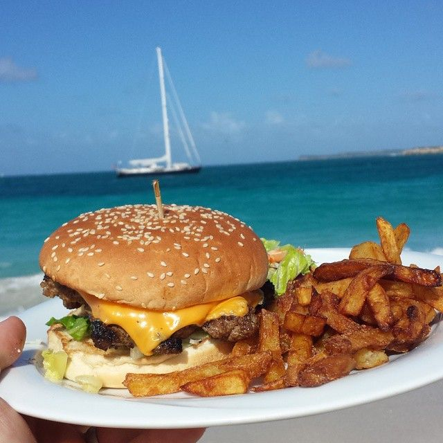 Now this is a damn good  cheeseburger in paradise!  I wish every burger came with this view. #stmartin #sunbeachclubber #burger #burgerporn #instaburger #food #foodporn #nyc #gotham #gothamburgersocialclub #burgerclub #cheers #beer #cheese #eeeeeats #eatfamous #foodpornshare #foodprnshare #yuumfood #myfab5 #shareyourburger #burgeroftheday #dailyburger