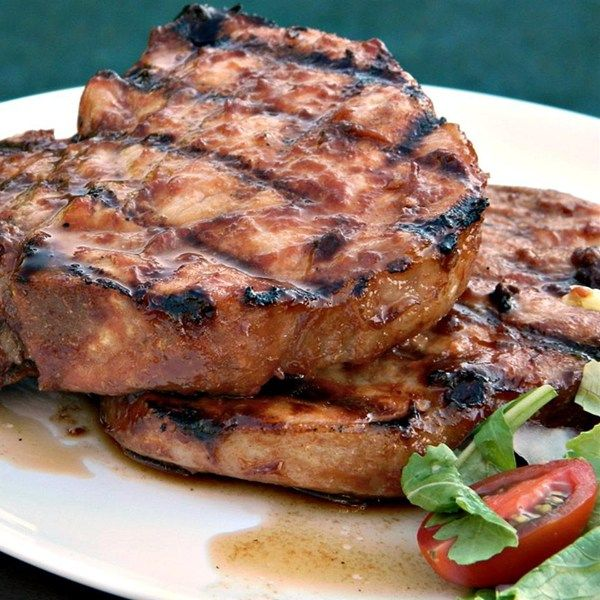 Early Autumn Smoked Pork Chops | Pork chops marinate in a sweet-savory sauce and are grilled with autumn leaves in the charcoals creating smoked pork chops perfect for the fall.