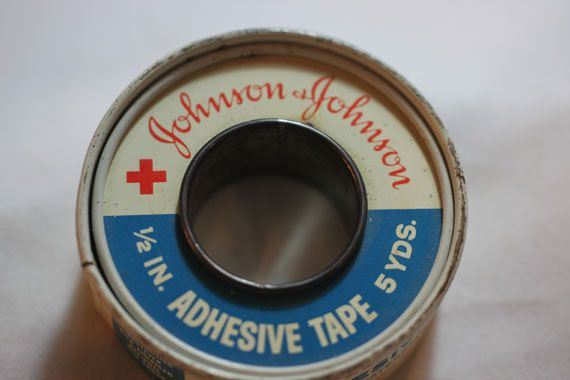First aid kit and what seemed the same tin of plaster throughout my childhood. I can still smell it