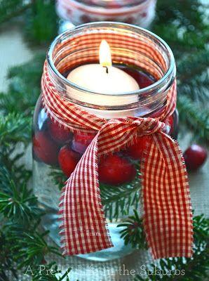Floating Candles Christmas Candle inside of a mason jar. diy Christmas decor pinboard by Asher Socrates. #christmas #pine #ribbon #candle #craft #ideas #diy #ashersocrates #masonjar #holiday