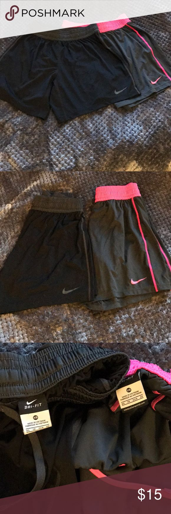 Nike Soccer Short Bundle Black pair with grey detailing and grey pair with pink detailing. Both draw string waist, longer fit. Both identical shorts in XS. Nike Shorts
