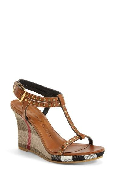 "Free shipping and returns on Burberry 'Harbeton' Wedge Sandal (Women) at Nordstrom.com. <p><B STYLE=""COLOR:#990000"">Pre-order this style today! Add to Shopping Bag to view approximate ship date. You'll be charged only when your item ships.</b></p><br>An iconic check print blankets the slim platform wedge of an edgy T-strap sandal punctuated in gleaming, rocker-chic studs."