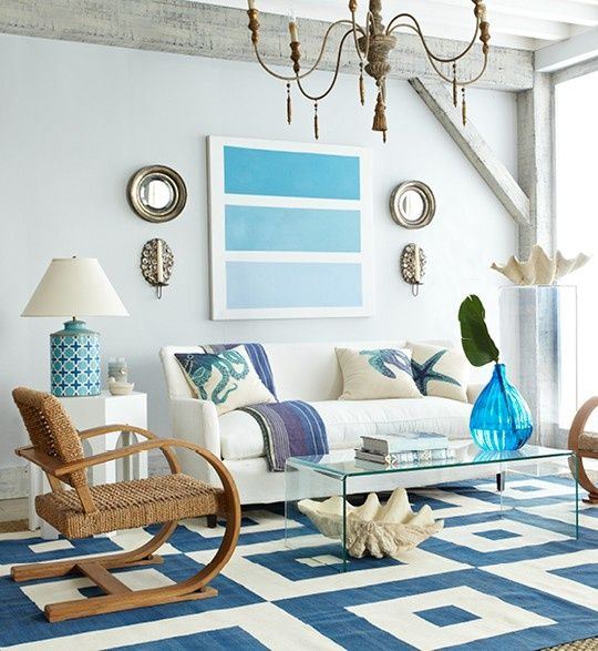 Great retro rattan chair paired with crisp blues and whites in this beach living space.
