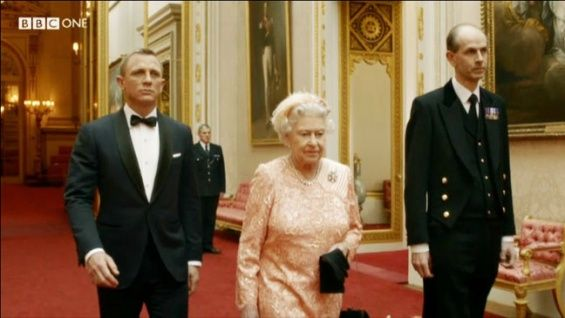 James Bond (Daniel Craig) escorts Queen Elizabeth II to the opening ceremony of the 2012 London Olympic Games.
