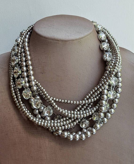 Check out this item in my Etsy shop https://www.etsy.com/ca/listing/521733814/multistrand-pearl-and-crystal-boho