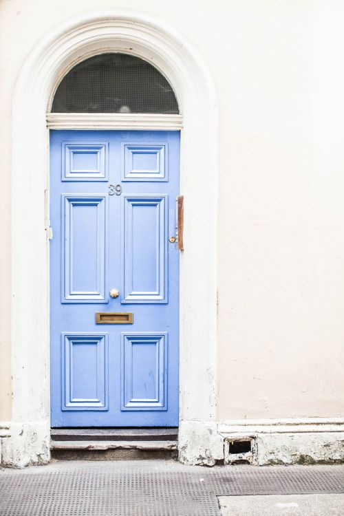 No. 39 makes a good impression w/ this light blue statement door! The blue really pops against the white surroundings & the gold door accessories.