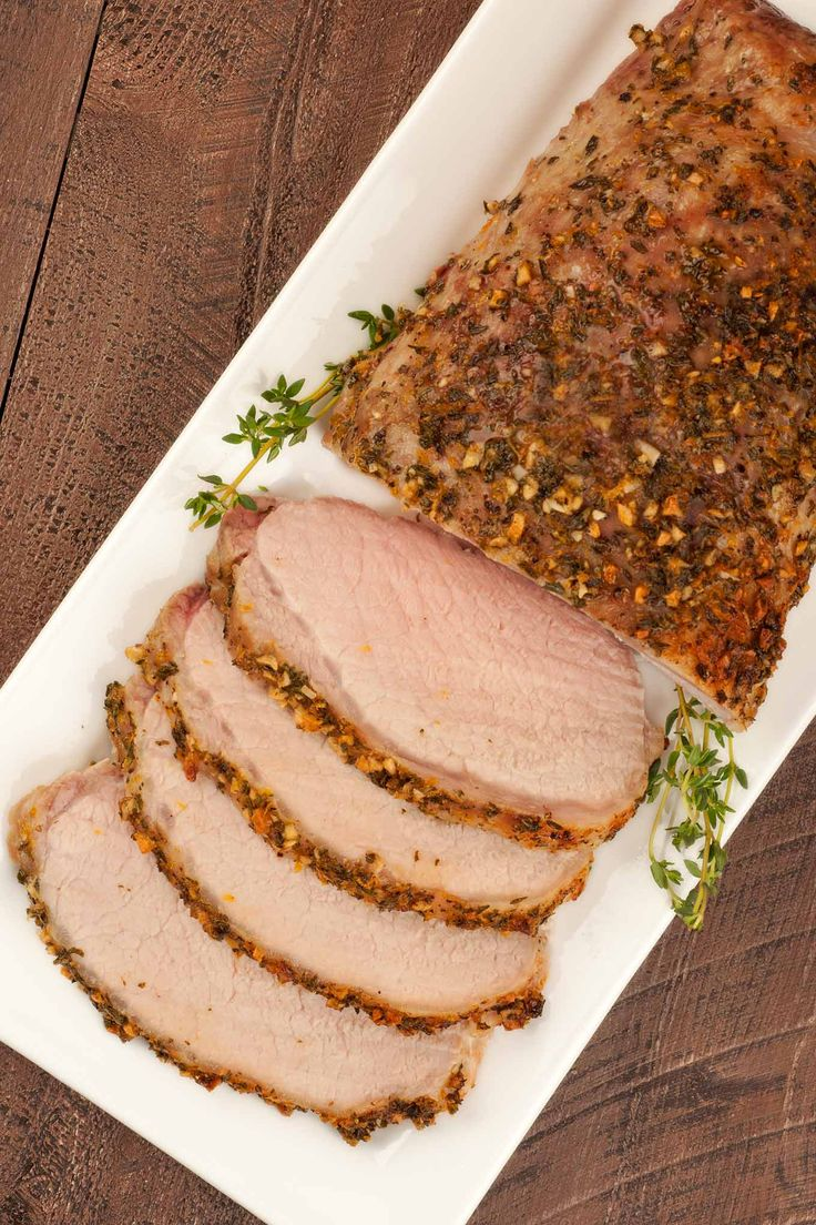 This tender and juicy boneless pork roast is coated in a delicious rub made with extra virgin olive oil, garlic and fresh herbs.