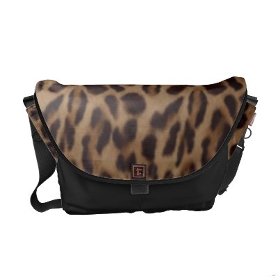"""Valxart leopard Bag is perfect as a workday commuter, or travel bag! Vibrantly printed on rugged polyester. This bag combines beautiful form, function, and a small ecological footprint.  Water resistant, extra durable (machine-washable).  Large main compartment and 2 front pockets.  Lightweight and forms to your body.  Quick-adjust cam shoulder strap.  Velcro strips accessory system; Holds a 13"""" laptop w/optional sleeve.  Dimensions 11"""" H x 12.5"""" W base x 18"""" W top x 6""""D"""