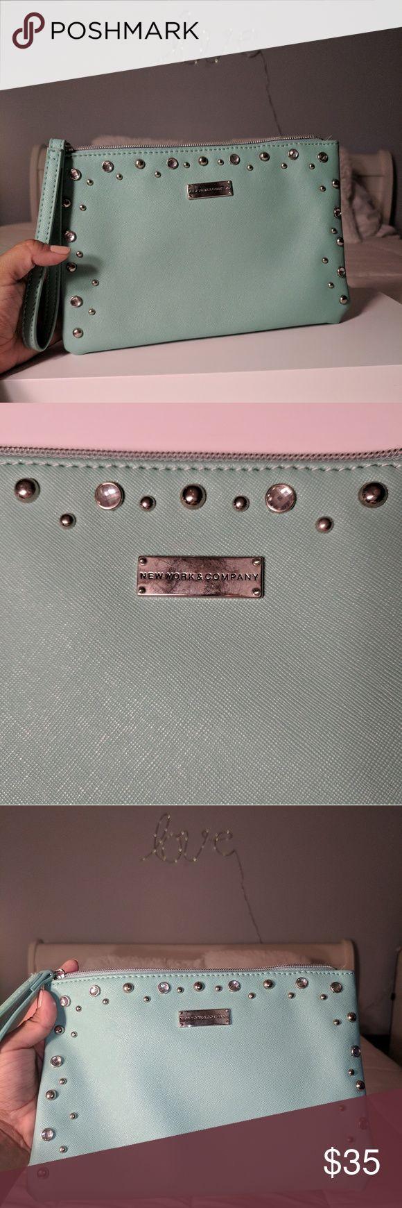 Mint blue studded clutch with wrist strap Mint blue New York & Company studded clutch with wrist strap. Used once. New York & Company Bags Clutches & Wristlets
