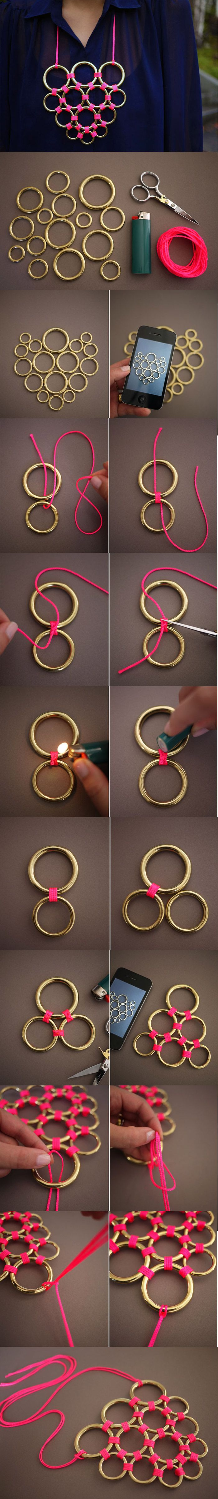 I would make this in to something other than a necklace.. continue the lattice of the rings into a screen of some kind