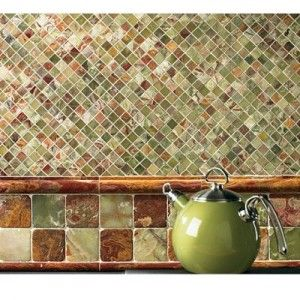 Tile backsplash...this one is nice & I like the larger tiles to break up the busy-ness.  Hmm, how would it look if the large tiles were in the middle?  Or on the top and bottom, like a border??