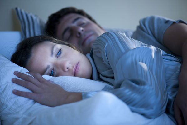 Waking up throughout the night may be frustrating, but there's reason to head back to bed with a mind at ease: Segmented sleep is normal, and without the anxiety you may avoid insomnia.