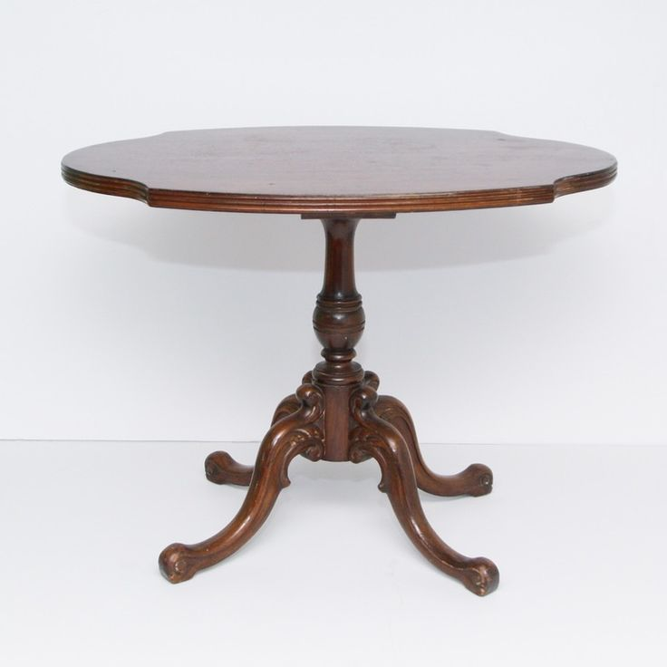 An Imperial of Grand Rapids(Michigan) pedestal table. The table features an oval top with cut-outs, reeded edge, turned column, decorative cabriole legs, and scroll feet. The table is marked to the underside with a a green and cream Imperial sticker, black and gold Grand Rapids, and black on yellow 2110 which indicates this table was made between 1939 and 1955.