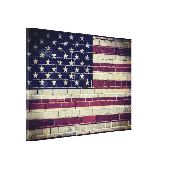 Vintage American flag on a brick wall Canvas Print