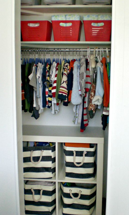 Love the Expedit shelving in the closet for more space. Really like those Ikea bins too! Perfect for the nursery