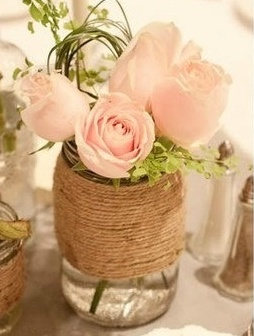 Bridesmaids bouquets inside mason jars as centerpieces on tables.  May wish to decorate mason jars with twine, ribbon, etc.