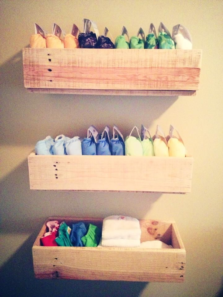 Cloth diaper storage. Craig is building! They're too cute to hide in a drawer.