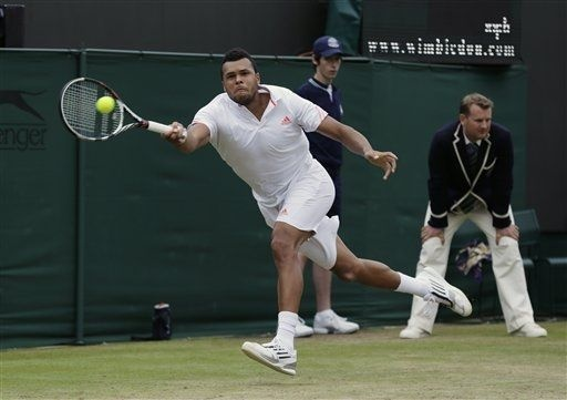 Jo-Wilfried Tsonga of France plays a shot to Mardy Fish of the United States during a fourth round singles match at the All England Lawn Tennis Championships at Wimbledon, England, Tuesday, July 3, 2012. (AP Photo/Sang Tan)