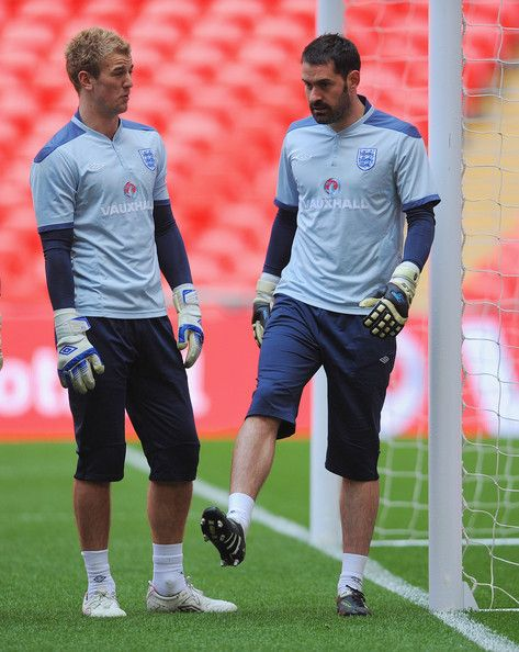 Scott Carson Photos Photos - Scott Carson and Joe Hart look on during the England training session ahead of the International Friendly match against Ghana at Wembley Stadium on March 28, 2011 in London, England. - England Training And Press Conference