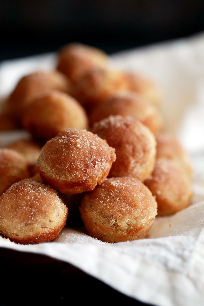 """TheseMini Applesauce Muffins require no special ingredients and are the perfect morning treat. A simple muffin batter flavored with applesauce will have you dreaming of crisp fall mornings and a delicious cinnamon sugar topping will have you reaching for """"just one more"""" over and over again."""