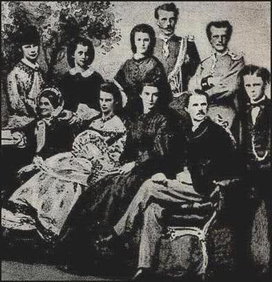The later Empress Elisabeth (Sisi) of Austria with her whole family (with Sisi on the left). Victorian era, family portrait.