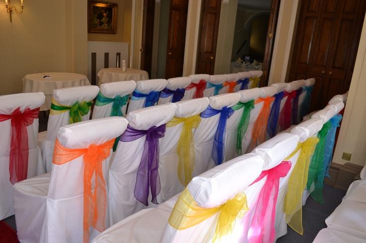 Rainbow Coloure Organza Bows on White Chair Covers