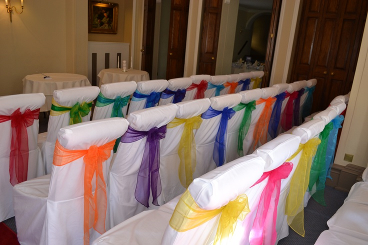 Rainbow Coloure Organza Bows on White Chair Covers