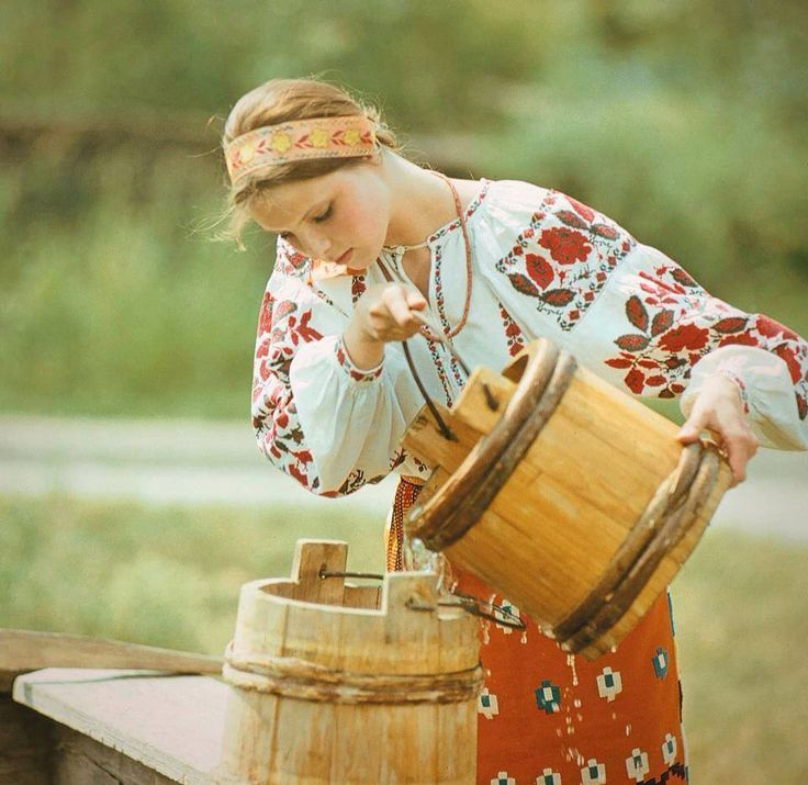 Cute Romanian girl in traditional outfit