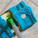 10+ idea's for recycling old towels - includes reusable swiffer mop cover, bath mat, terry cloth caddy, spa slippers, upcycled beach bag, and more!