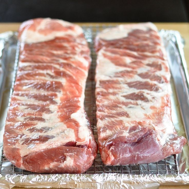 How To Make Great Ribs in the Oven | Rib meat is fairly tough, and it needs a long time to break down and become tender. The oven is actually an ideal environment for this kind of slow and steady cooking. Lifting the ribs above the baking sheet on a rack also lets the heat circulate on all sides. After a few hours, the meat is nearly falling off the bone and you'll be licking your fingers in no time.