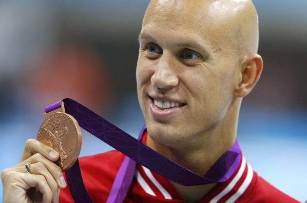 Canada's Brent Hayden holds his bronze medal during the men's 100m freestyle victory ceremony at the London 2012 Olympic Games at the Aquatics Centre