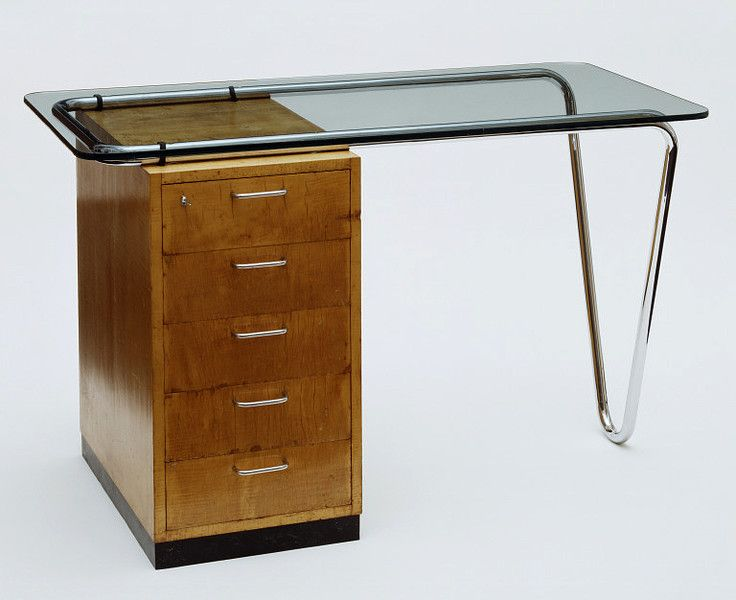 Desk, Bristol, England (made) - 1935-36.  Marcel Breuer. / The desk, designed by Hungarian born architect and designer Marcel Breuer has an interesting history from its patronage to its design and beyond. The desk was commissioned by Dorothea Ventris, a committed collector of contemporary art and design, for her home in Highpoint I, a block of flats in Hampstead, London. Highpoint was itself a modernist building designed by the Russian-born architect Bertold Lubetkin.