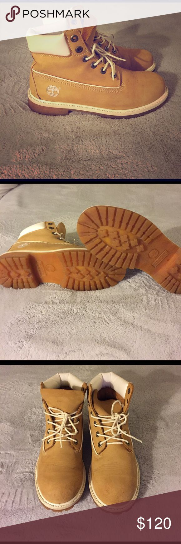 Timberland size (6 boys- 7-1/2 to 8 in women's) Tan original Timberland color with white accents. Fits size 7 1/2 to 8 in women's., lil scuffs but over great condition. Price negotiable...; ) Timberland Shoes Combat & Moto Boots