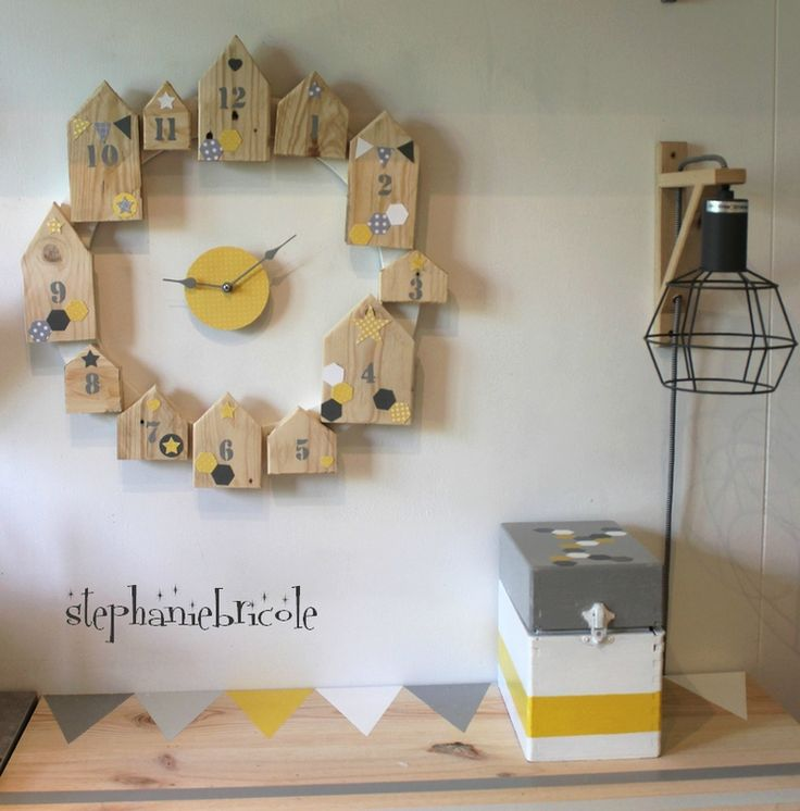 Little Houses Wall Clock. What a good idea & with the actual cloak work seperate from the houses themselves you could do other decorative surrounds as well. But I do love the houses I must admit ;)