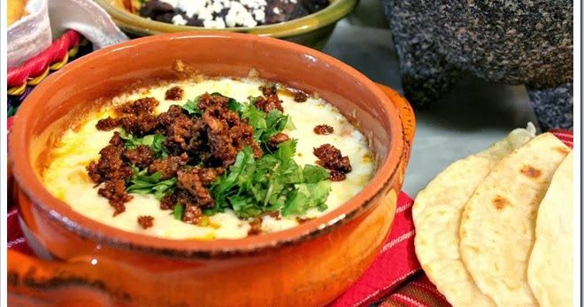 """Queso fundido, Mexican melted cheese with chorizo, also known as """" Choriqueso"""". You can quickly prepare it at home, over the stove, in your oven, on the grill, well even in the microwave! Two ingredients and enjoy!"""