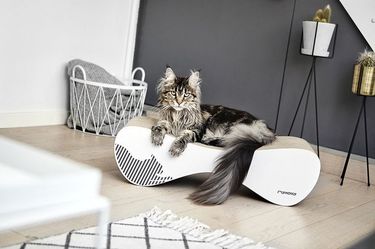 The white VIGO cardboard cat scratcher by myKotty is a stylish, multifunctional piece of cat furniture that playful pussies will love getting their claws into.