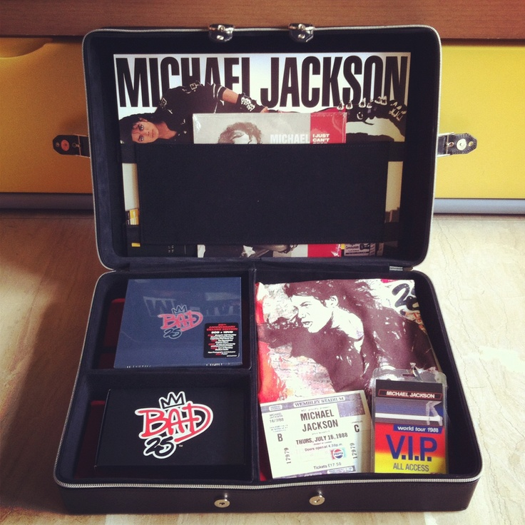 """Deluxe limited edition Michael Jackson Bad25 briefcase, includes Bad25 3CD+DVD box set, Bad25 earphones, exclusive Bad25 T-shirt, replica of original Bad tourbook, VIP lanyard and Wembley concert ticket, and I Just Can't Stop Loving You individually-numbered 7"""" vinyl single."""
