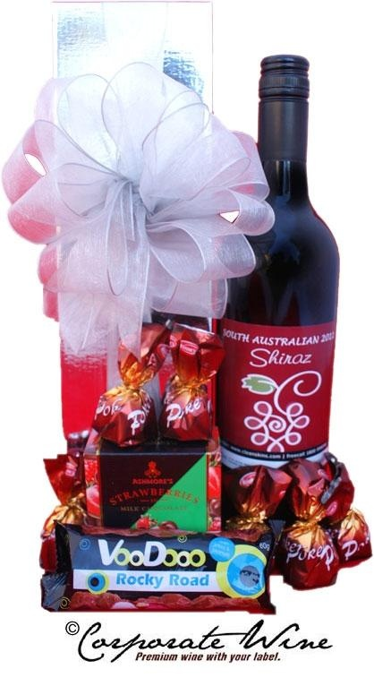 Sweet chocolate treats, jams  and a bottle of South Australian Shiraz beautifully presented in this Corporate Wine Gift Hamper