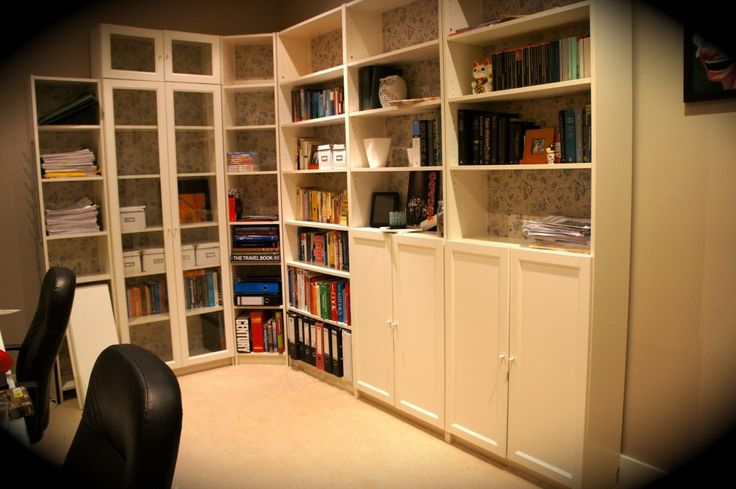 Bookshelves Some With Doors Note The Wallpaper On The