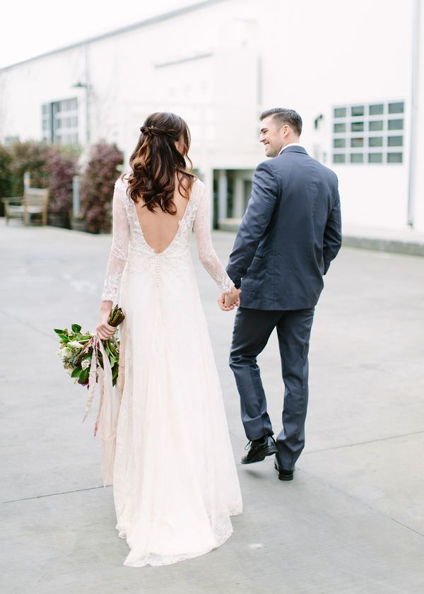 Modern bride and groom wedding inspiration with a statement back wedding dress and classic tuxedo.