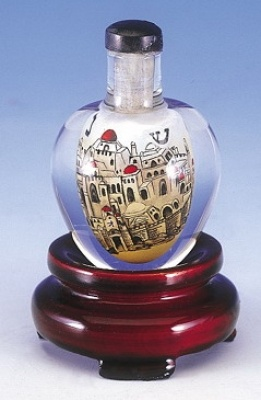 Crystal Dreidel  Balanced On A Carved Wooden Stand, A Hand Cut, Hand Polished Crystal Dreidel Holds, Deep In Its Interior, An Exquisitely Detailed Artist's Interpretation Of The Ancient City Of Jerusalem. Painstakingly Executed, Each Scene Is Individually Hand Painted, In Reverse, On The Interior Of This Collectible Dreidel.